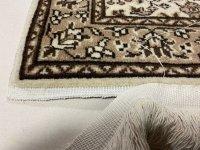 手織絨毯の房修理
